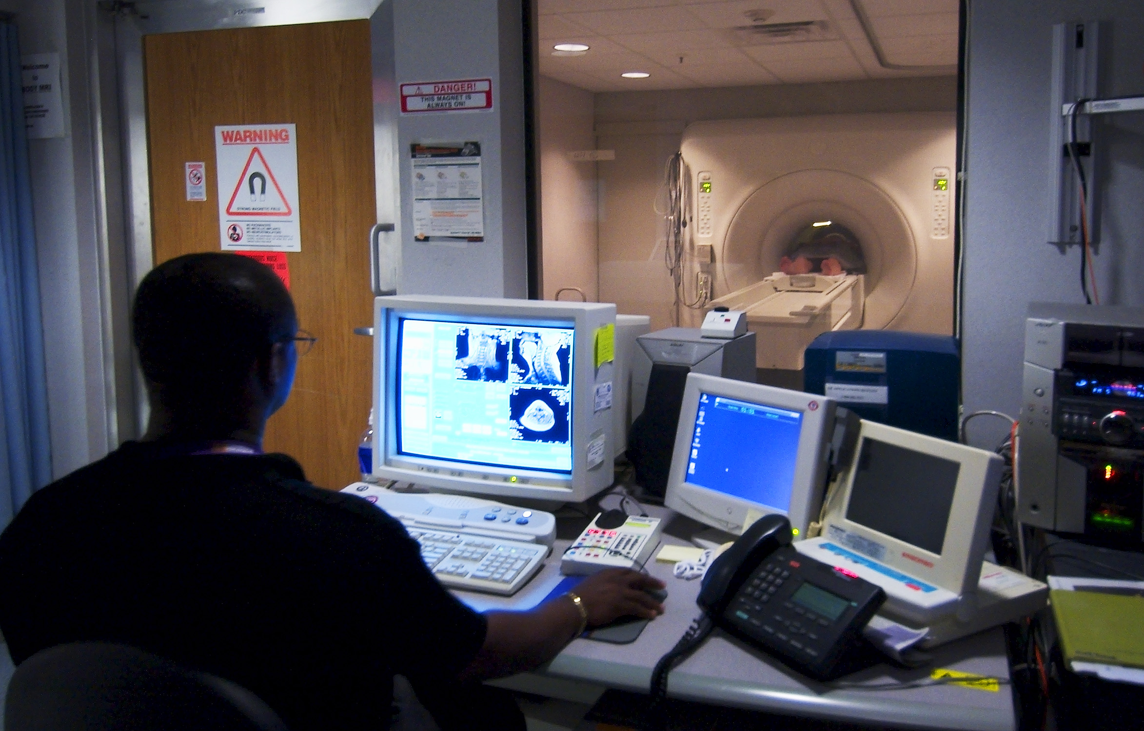MRI technologist in a control room.