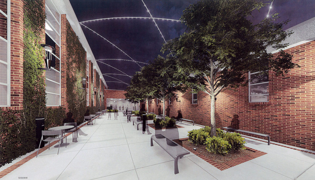 West entrance to the renovated A.J. Theisen building is shown in this architect's rendering.