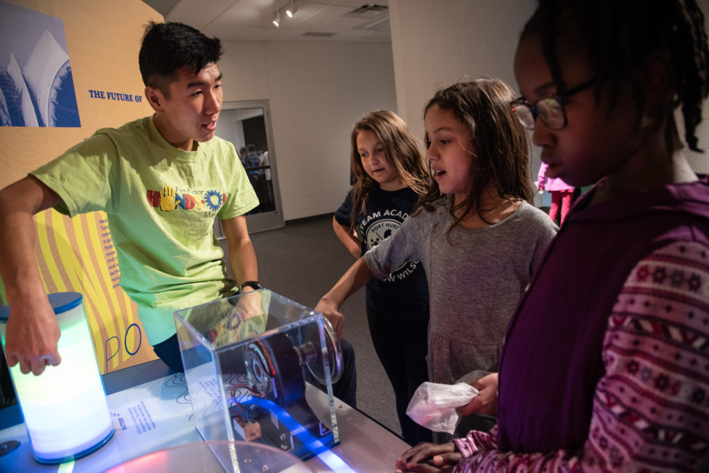 Young students shown engaging with wind exhibit in Experience Center