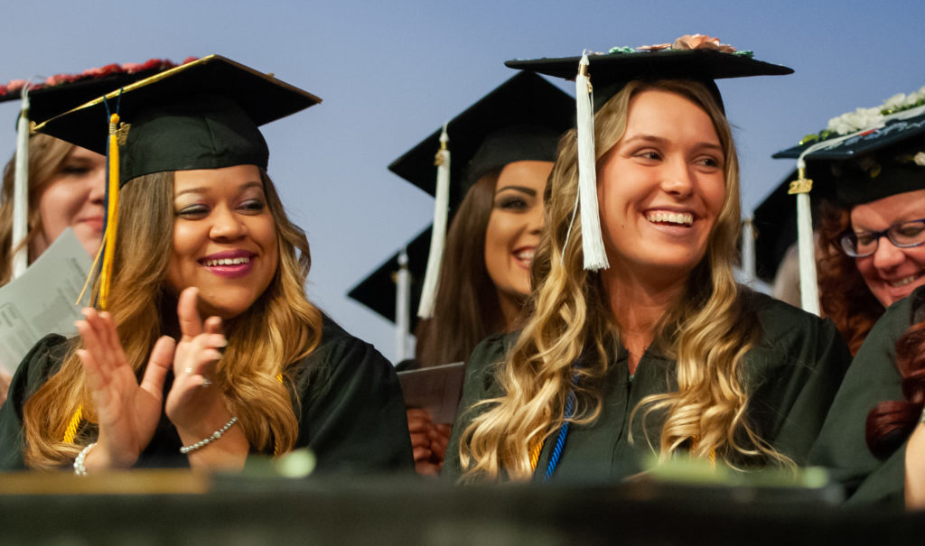 Two female students pictured at Commencement