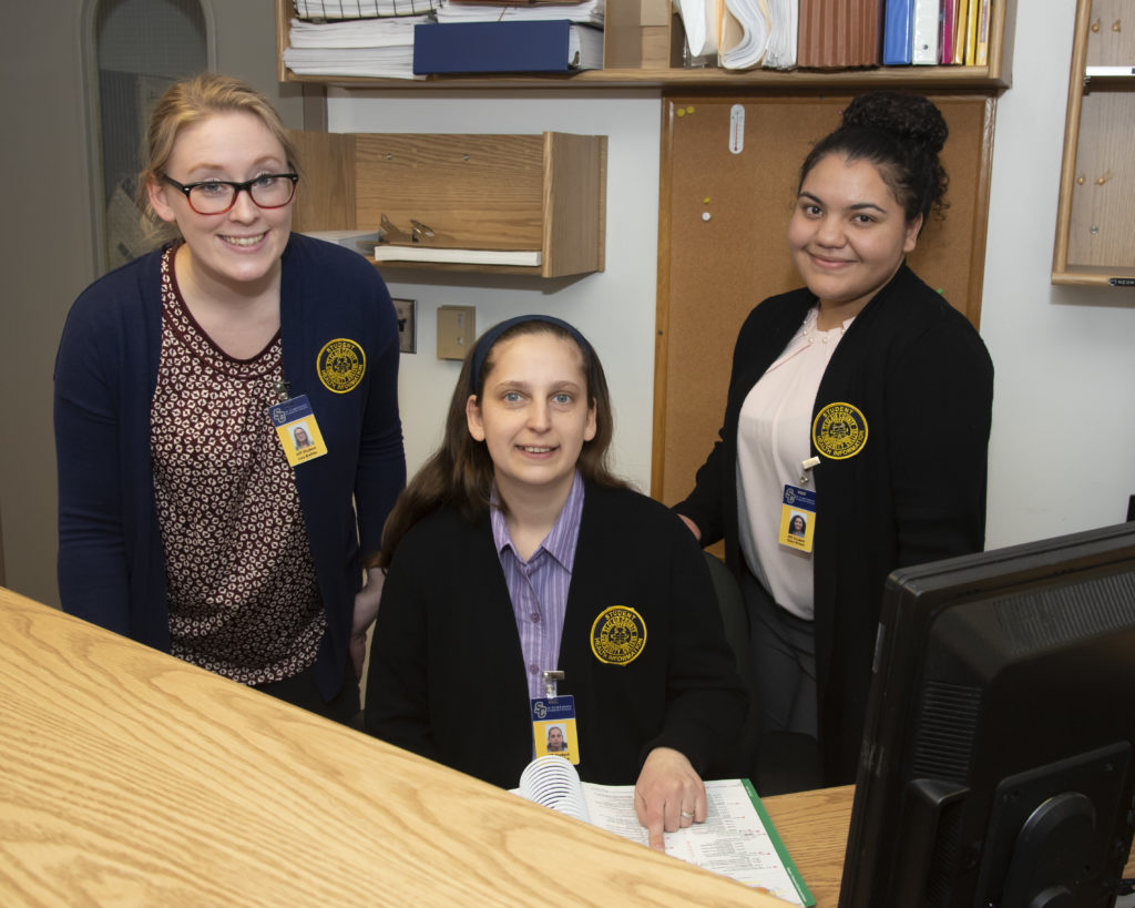 Three Health Information Technology students working