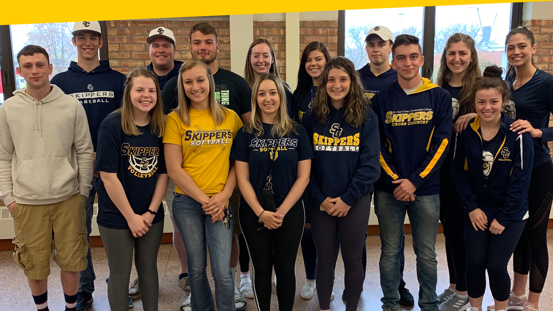 A group of Skippers athletes pose for photo in the Student Center.