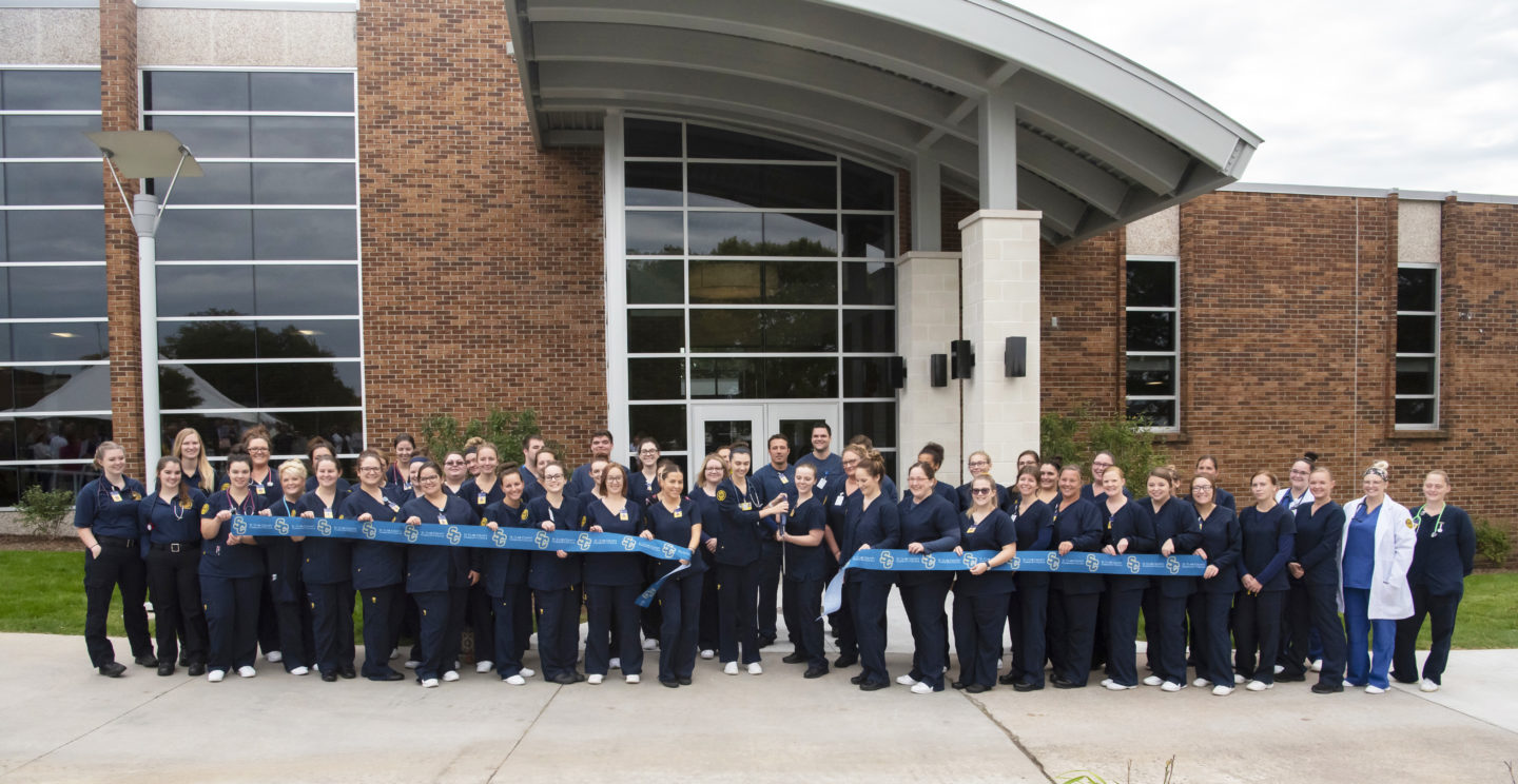 Health sciences students cut ribbon at grand opening event celebration