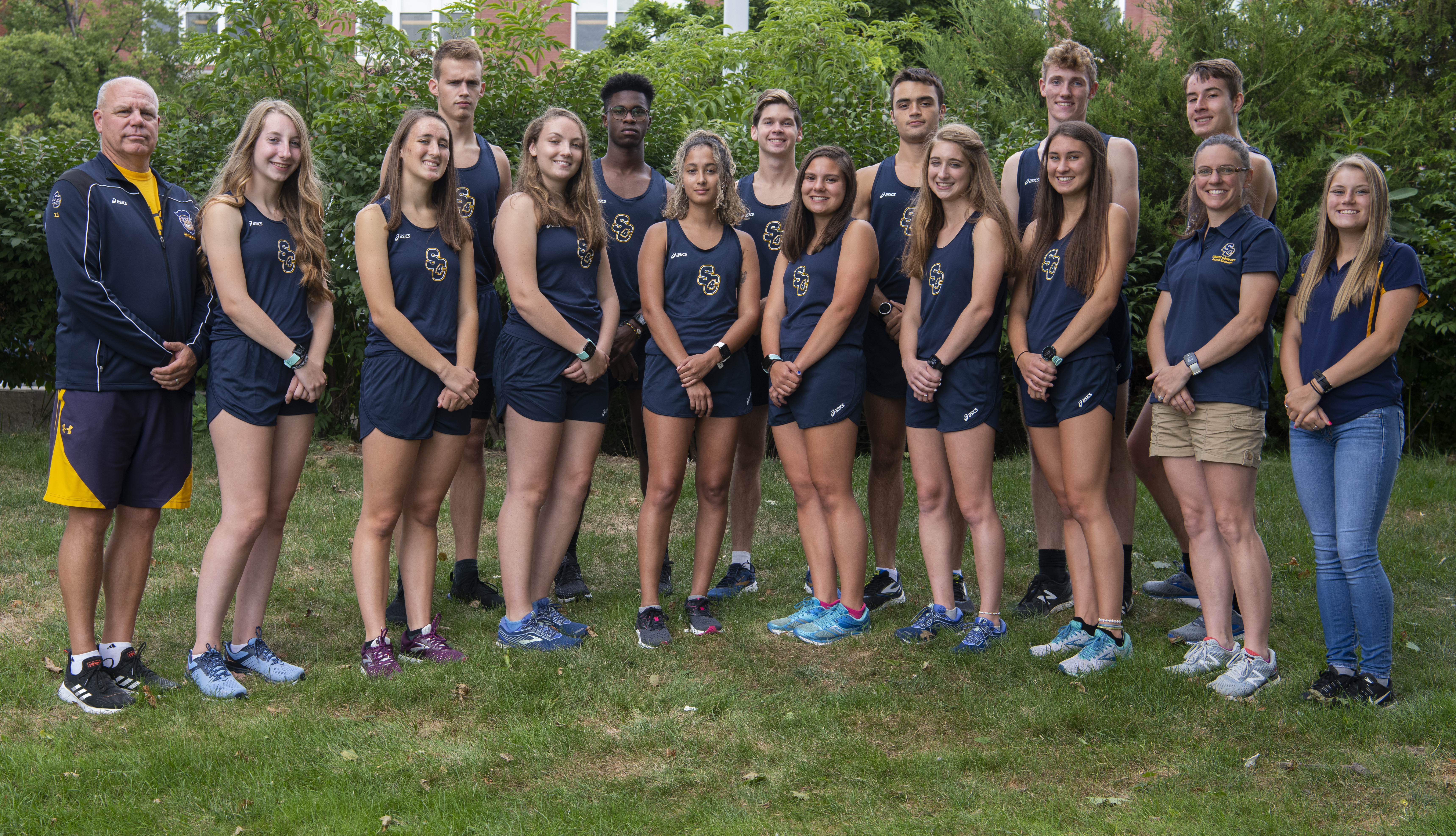 SC4 fall 2019 men's and women's cross country teams pose for a photo together.